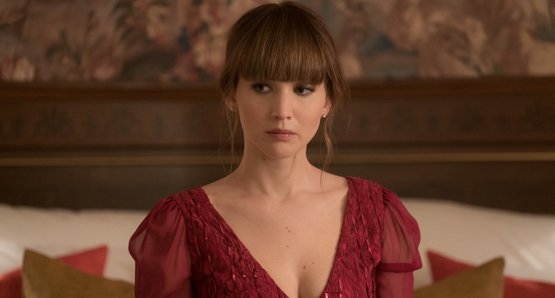 "Jennifer Lawrence (as Dominika Egorova) in a red dress in ""Red Sparrow"""
