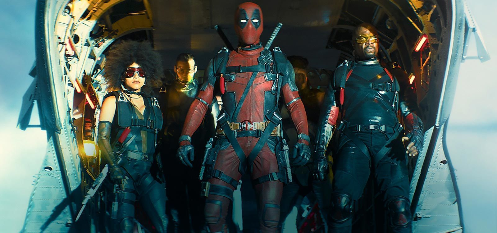 "Actors Zazie Beetz (as Domino), Bill Skarsgård( as Zeitgeist), Ryan Reynolds (as Deadpool) and Terry Crews (as Bedlam) standing at exit of a plane in the movie ""Deadpool 2"""