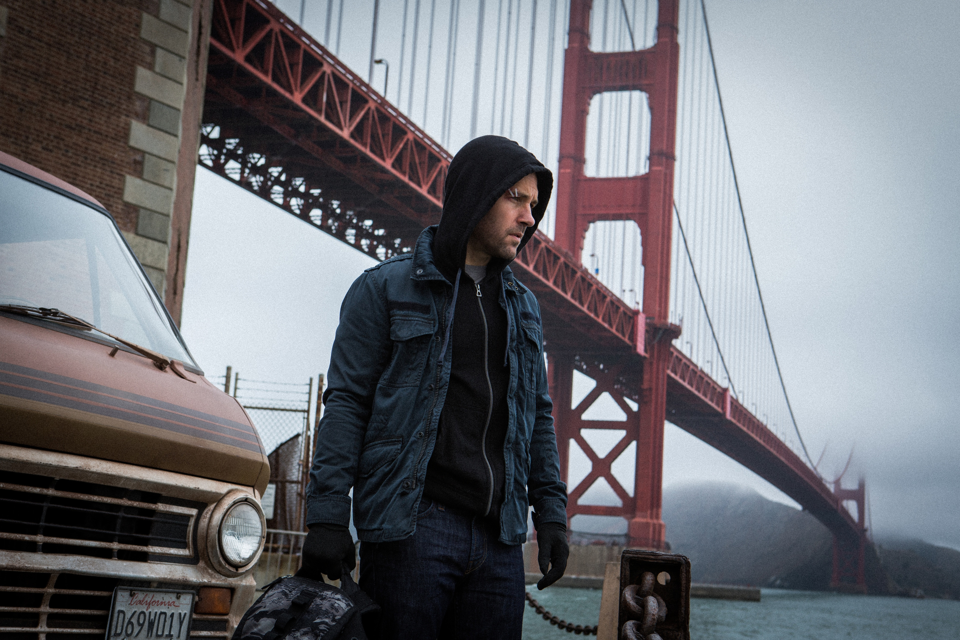 """Paul Rudd as Scott Lang standing in front of the golden gate bridge in the movie """"Ant-Man"""""""