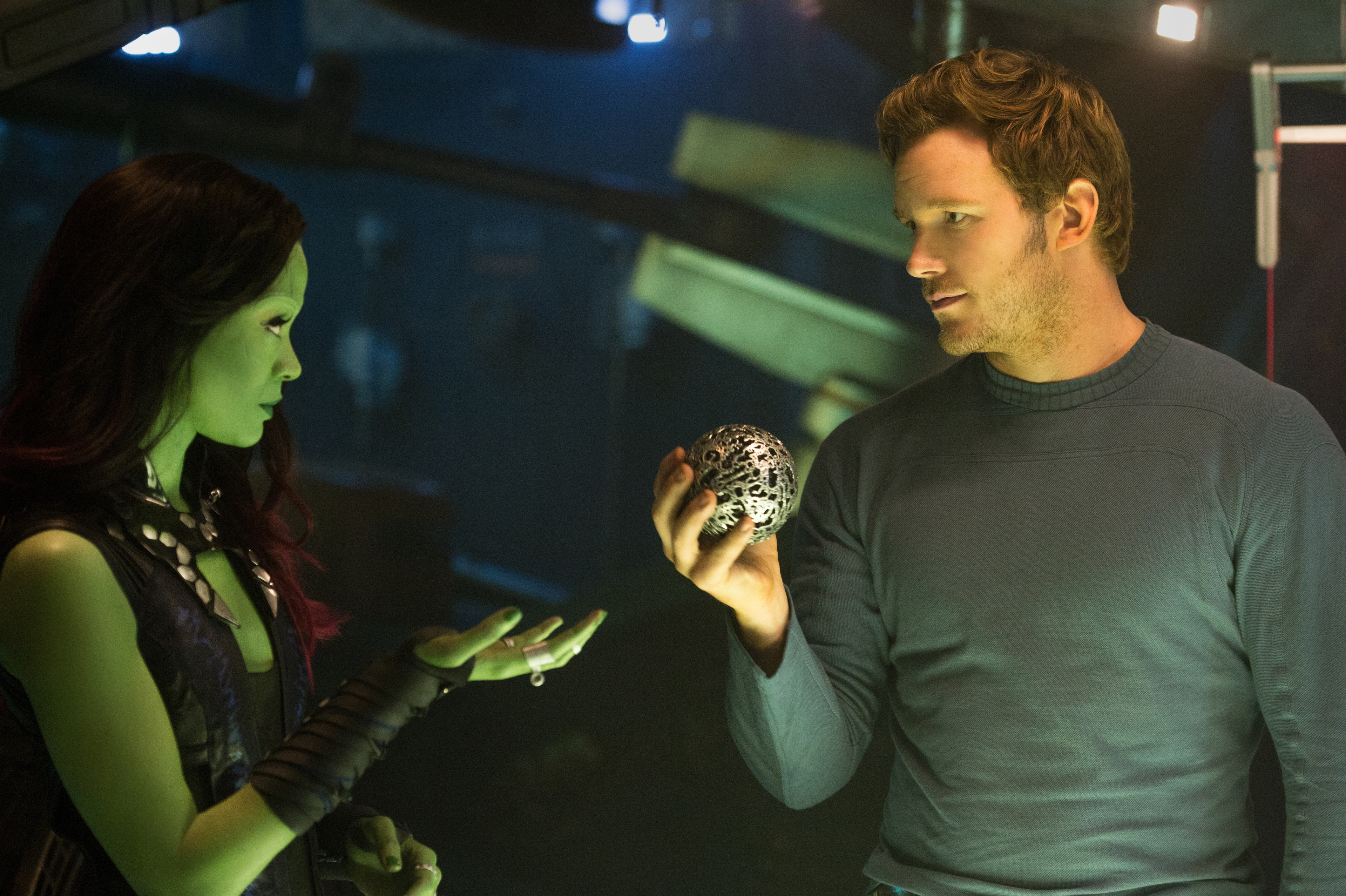 Gamora and Quill talking in Guardians of the Galaxy while Quill holds an orb