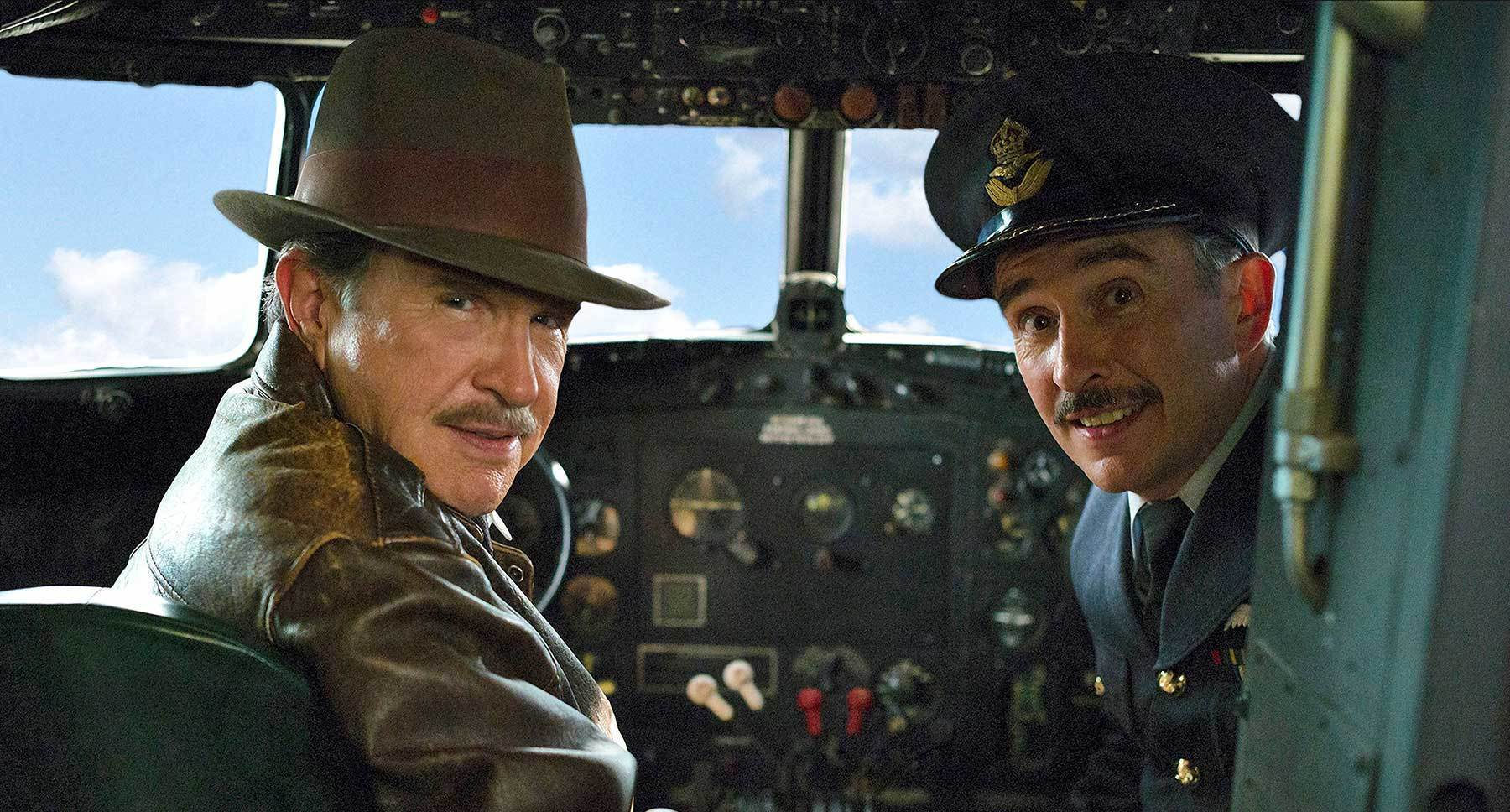 "Warren Beatty (as Howard Hughes) and Steve Coogan (as Colonel Nigel Briggs) sitting in the cockpit of a plane in ""Rules Don't Apply"""