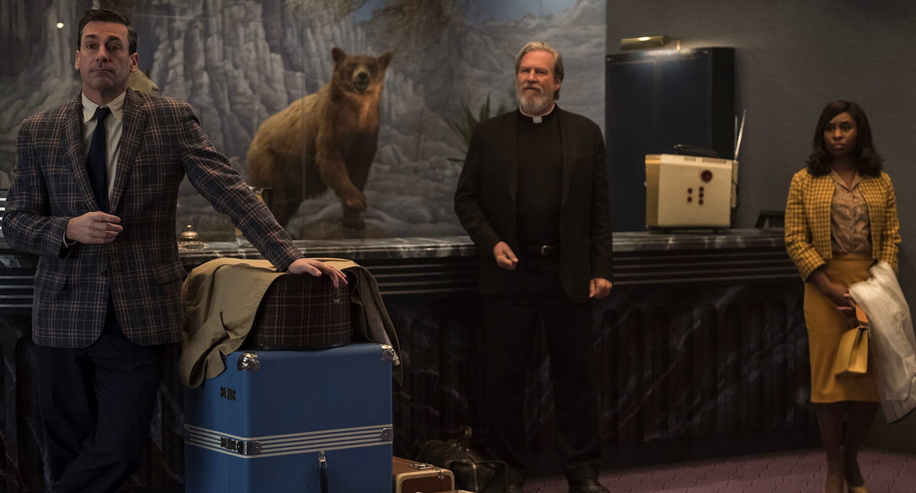 "Actors John Hamm (as Laramie Seymour Sullivan), Jeff Bridges (as Father Daniel Flynn), and Cynthia Erivo (as Darlene Sweet) in the movie "" Bad Times At The El Royale"""