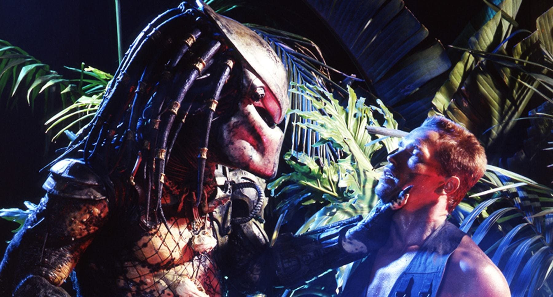 "Arnold Schwarzenegger (as Dutch) and the Predator in the movie ""Predator"""