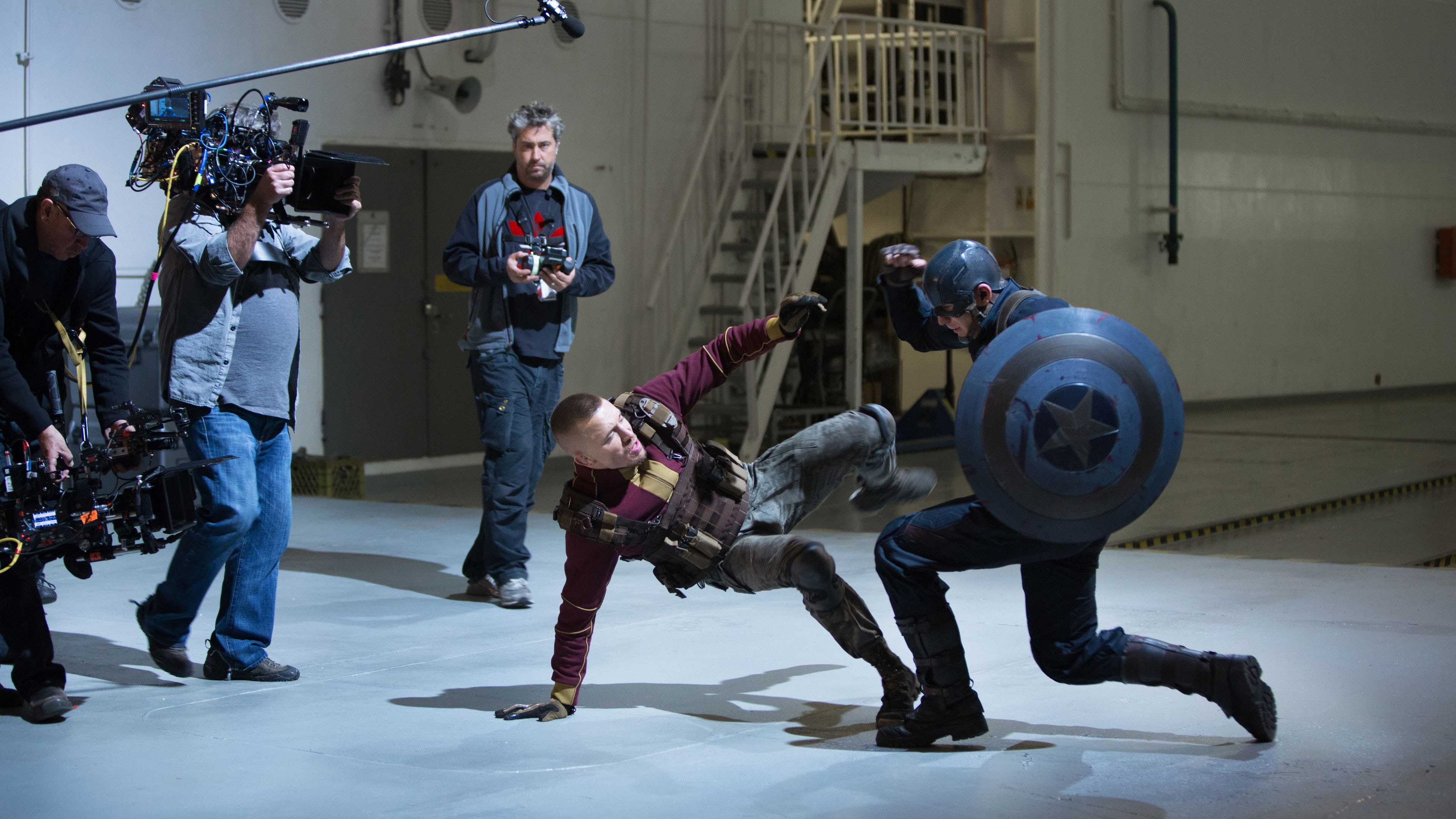 Actors Chris Evans (Captain America) and Georges St-Pierre (Georges Batroc) behind-the-scenes fighting in Captain America: The Winter Soldier.