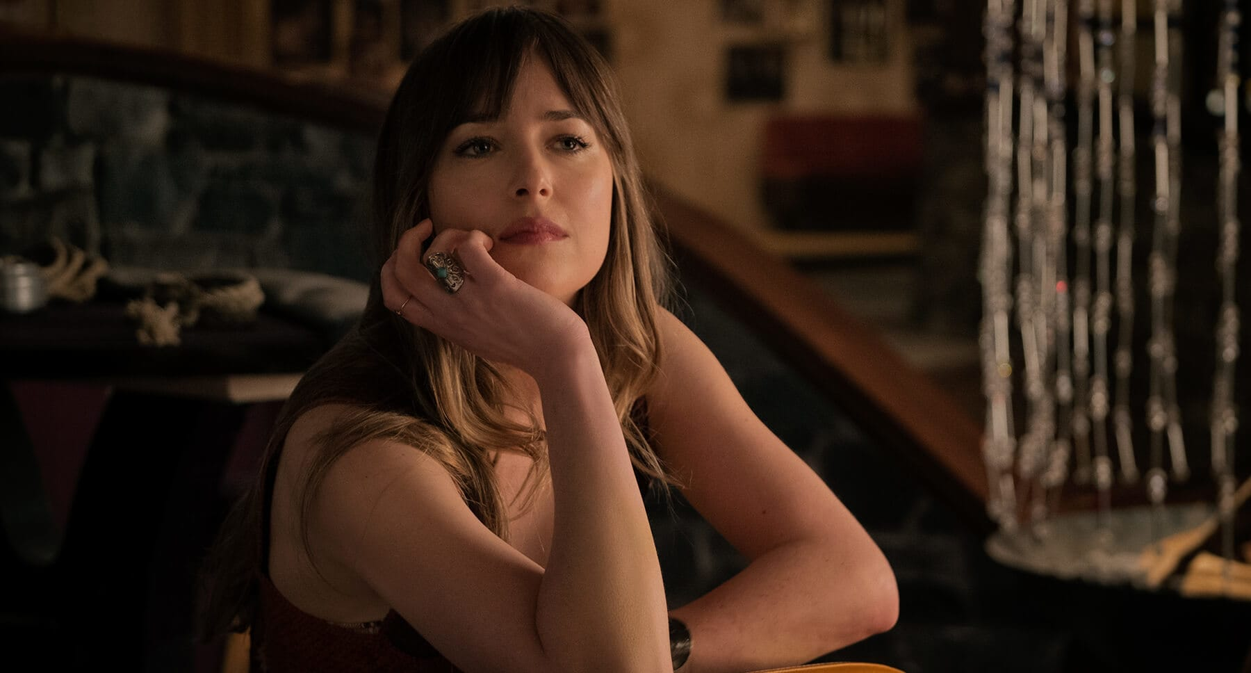 "Dakota Johnson (as Emily Summerspring) in the movie ""Bad Times In The El Royale"