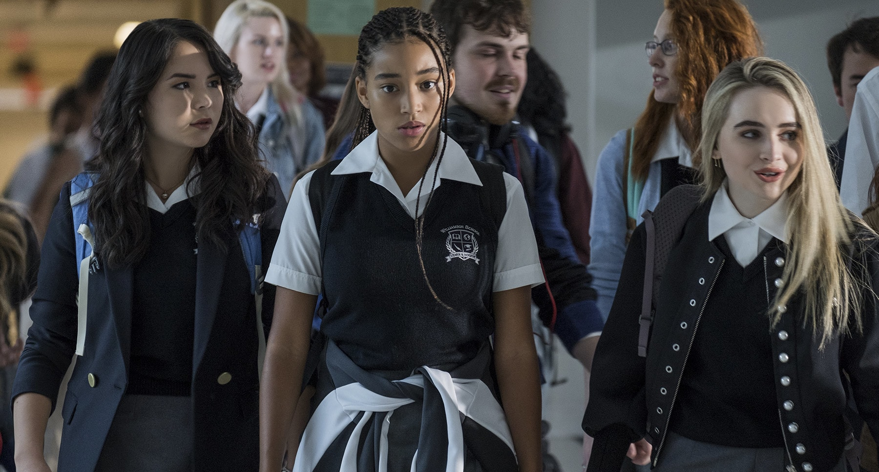 "Students Maya (Megan Lawless), Starr Carter (Amandla Stenberg) and Hailey (Sabrina Carpenter) at private school in the movie ""The Hate U Give"""