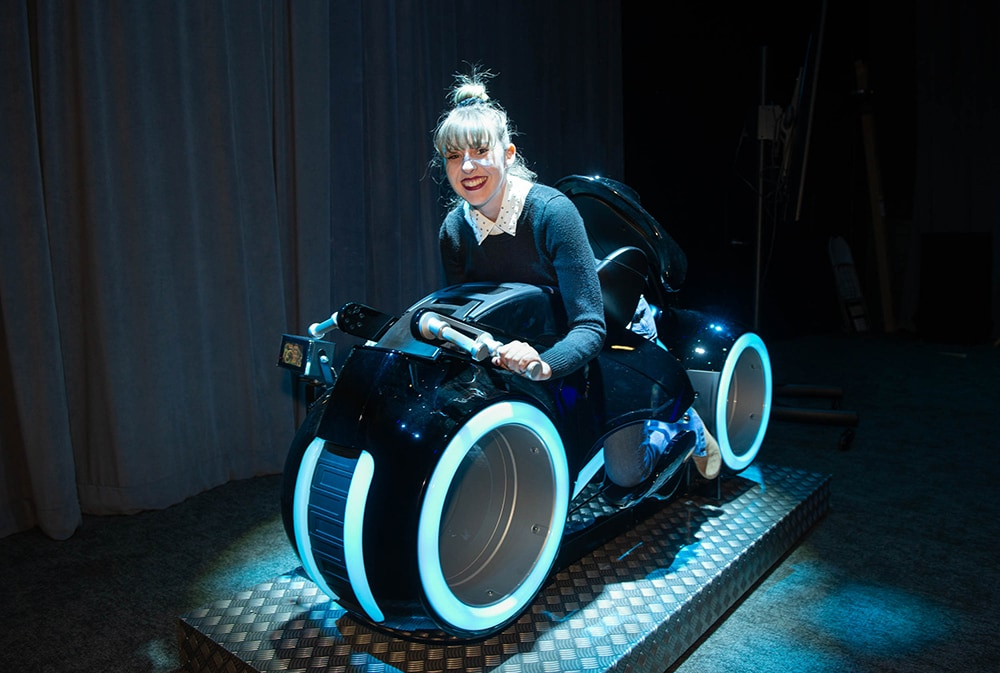 Disney News Super Star riding the Tron Lightcycle bike