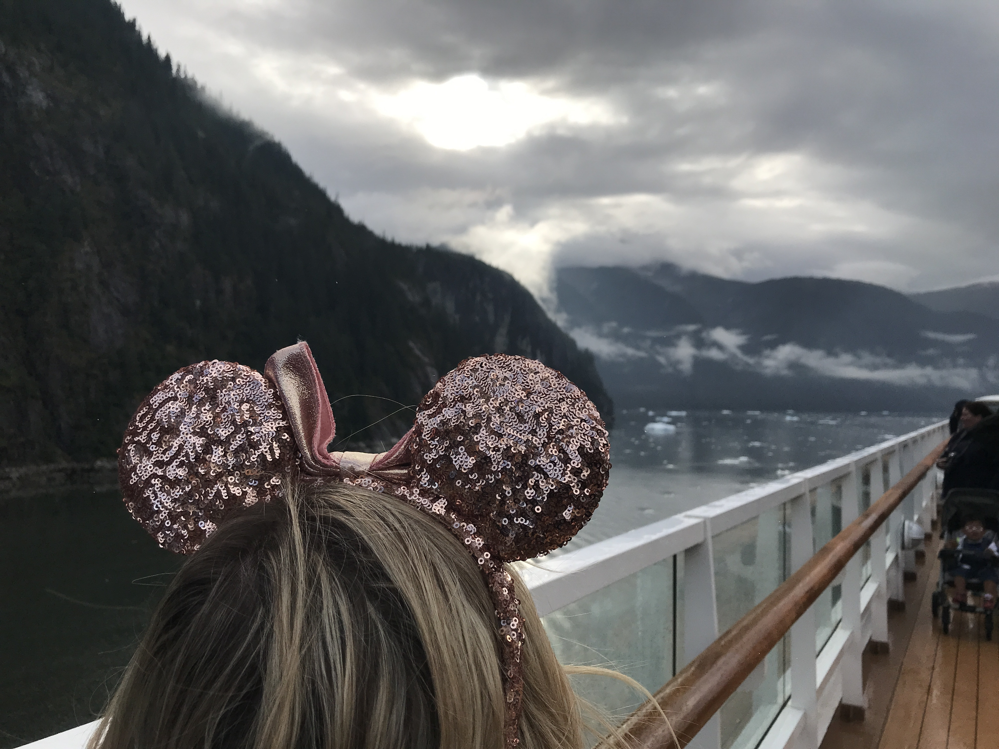 Tracy Arm View Off the Top Deck of the Disney Wonder with Oh My Disney Host wearing Minnie Ears