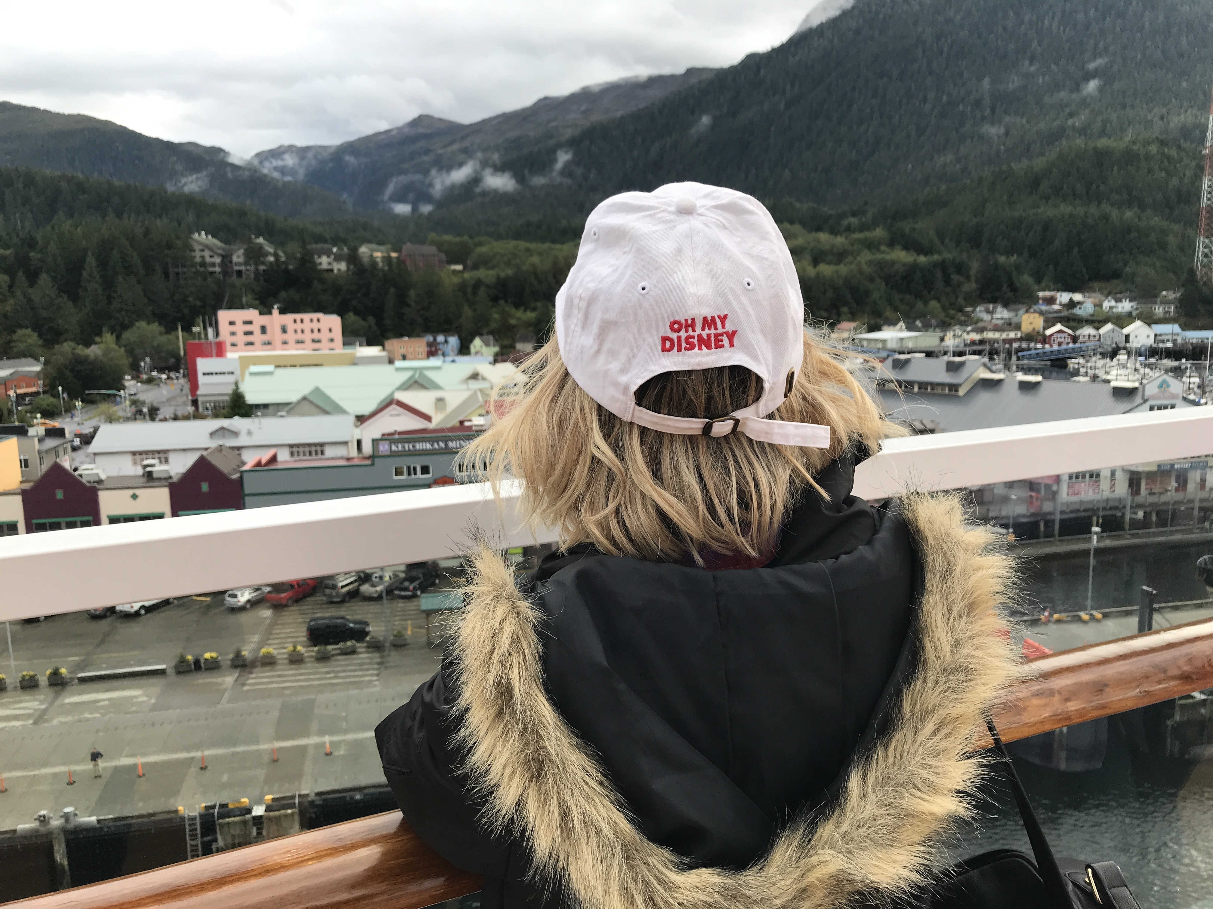 View of Ketchikan From the Disney Wonder Deck on the Disney Alaska Cruise with Host Wearing Oh My Disney Hat