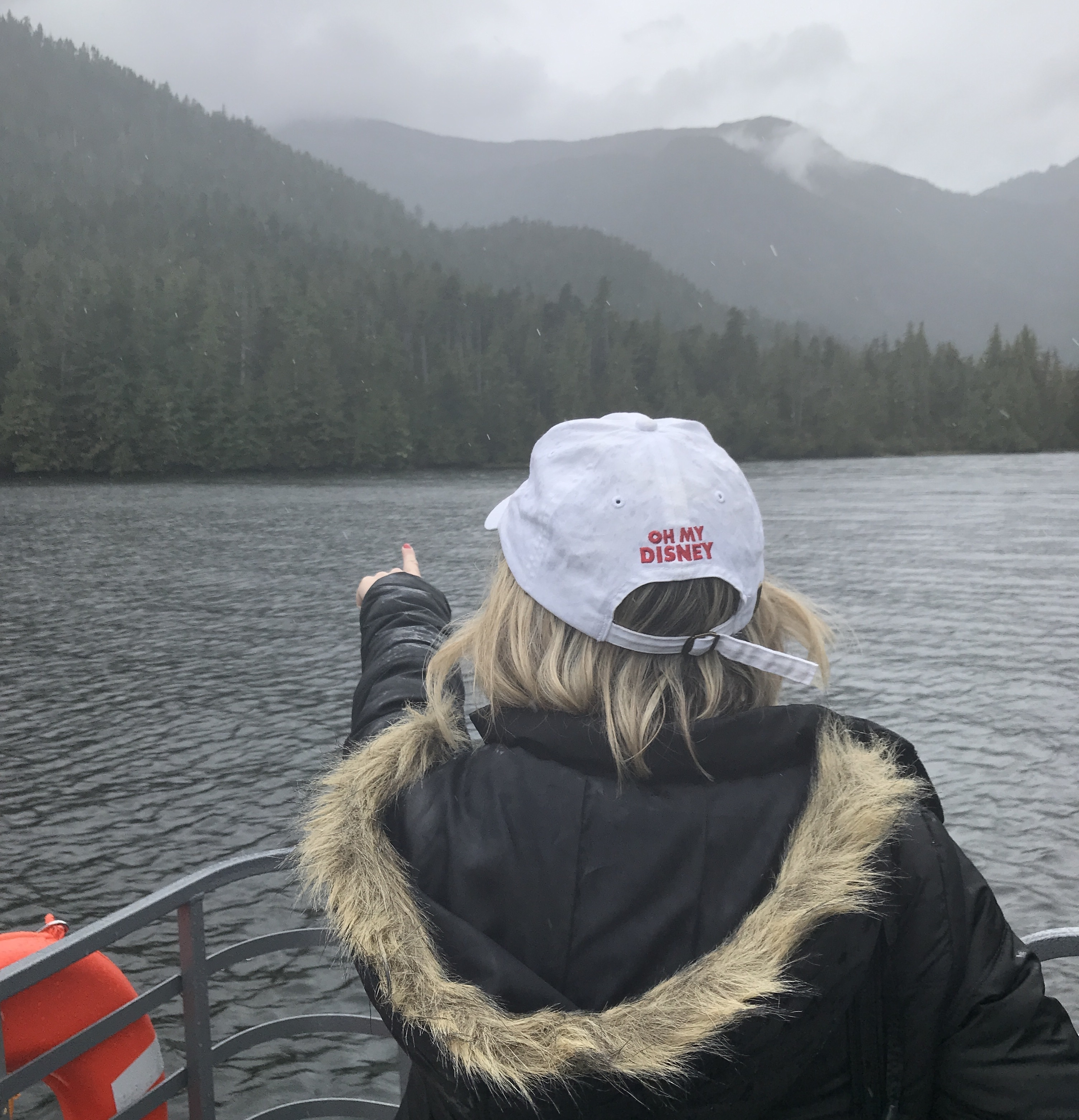 Ketchikan Boat Excursion on Disney Wonder Alaska Cruise with Host Wearing Oh My Disney Hat