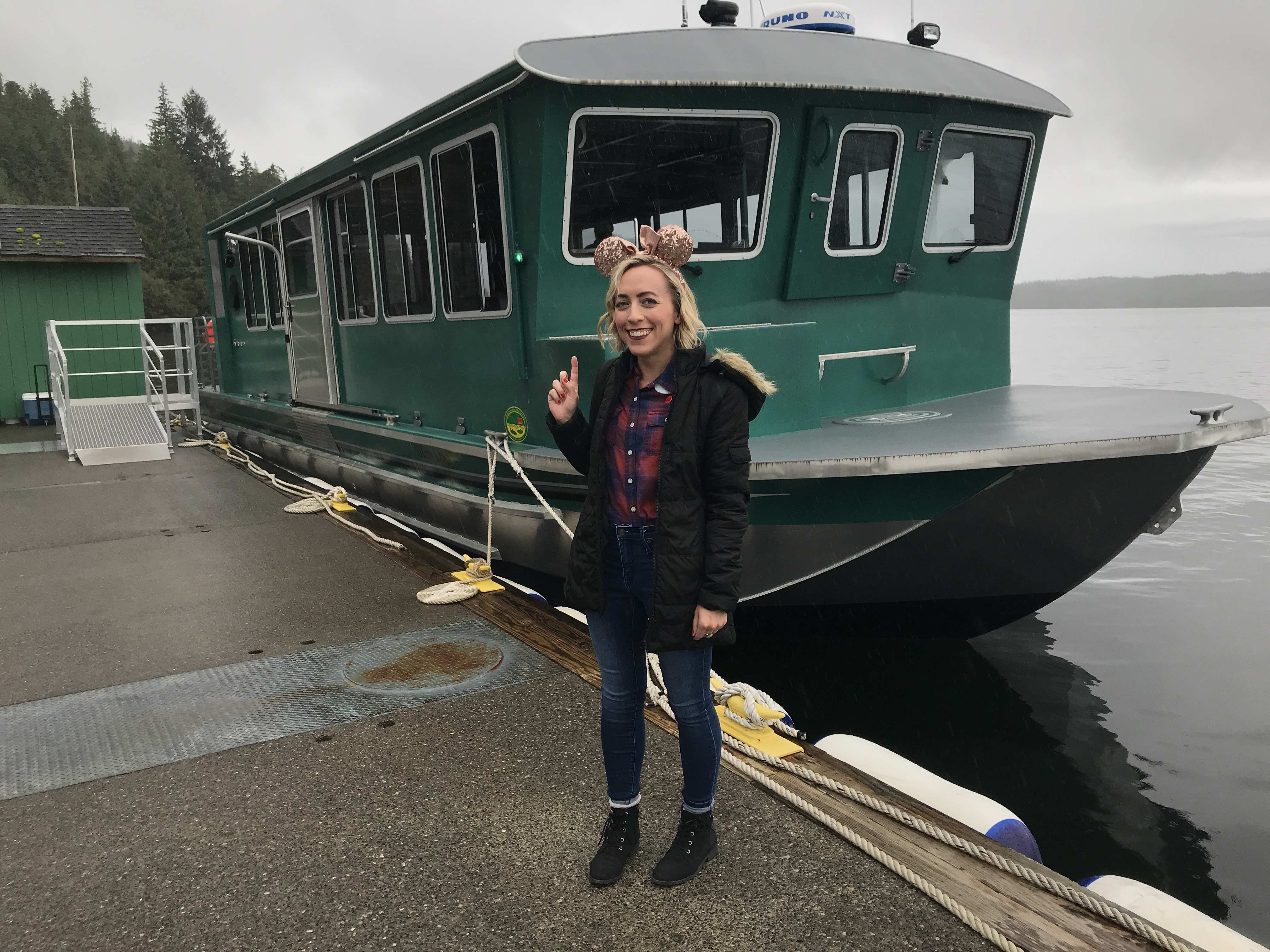 Oh My Disney Host Michelle Lema in front of Ketchikan Boat Excursion on the Disney Wonder Alaska Cruise
