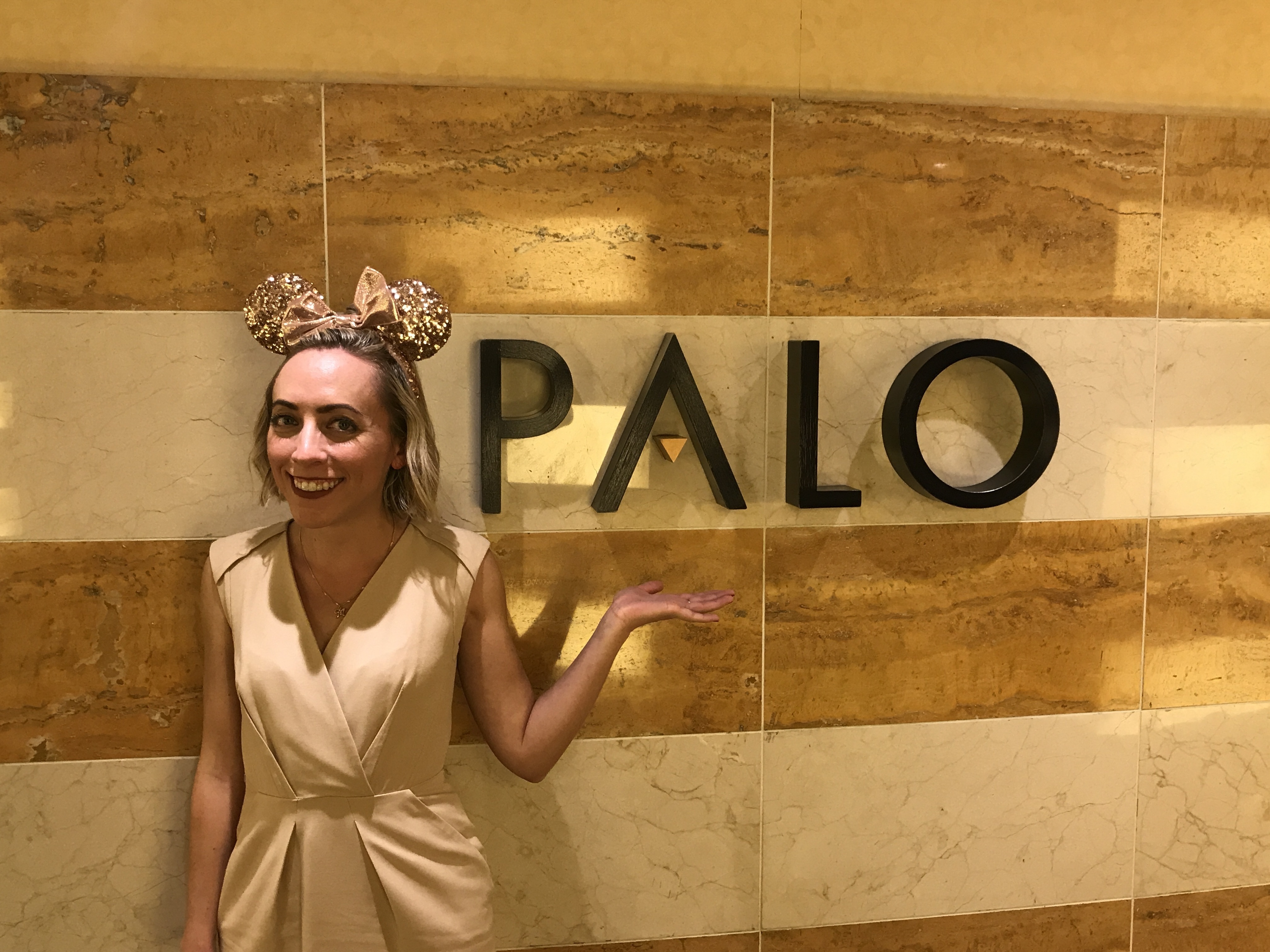 Palo Restaurant sign on the Disney Wonder with Oh My Disney Host Michelle Lema