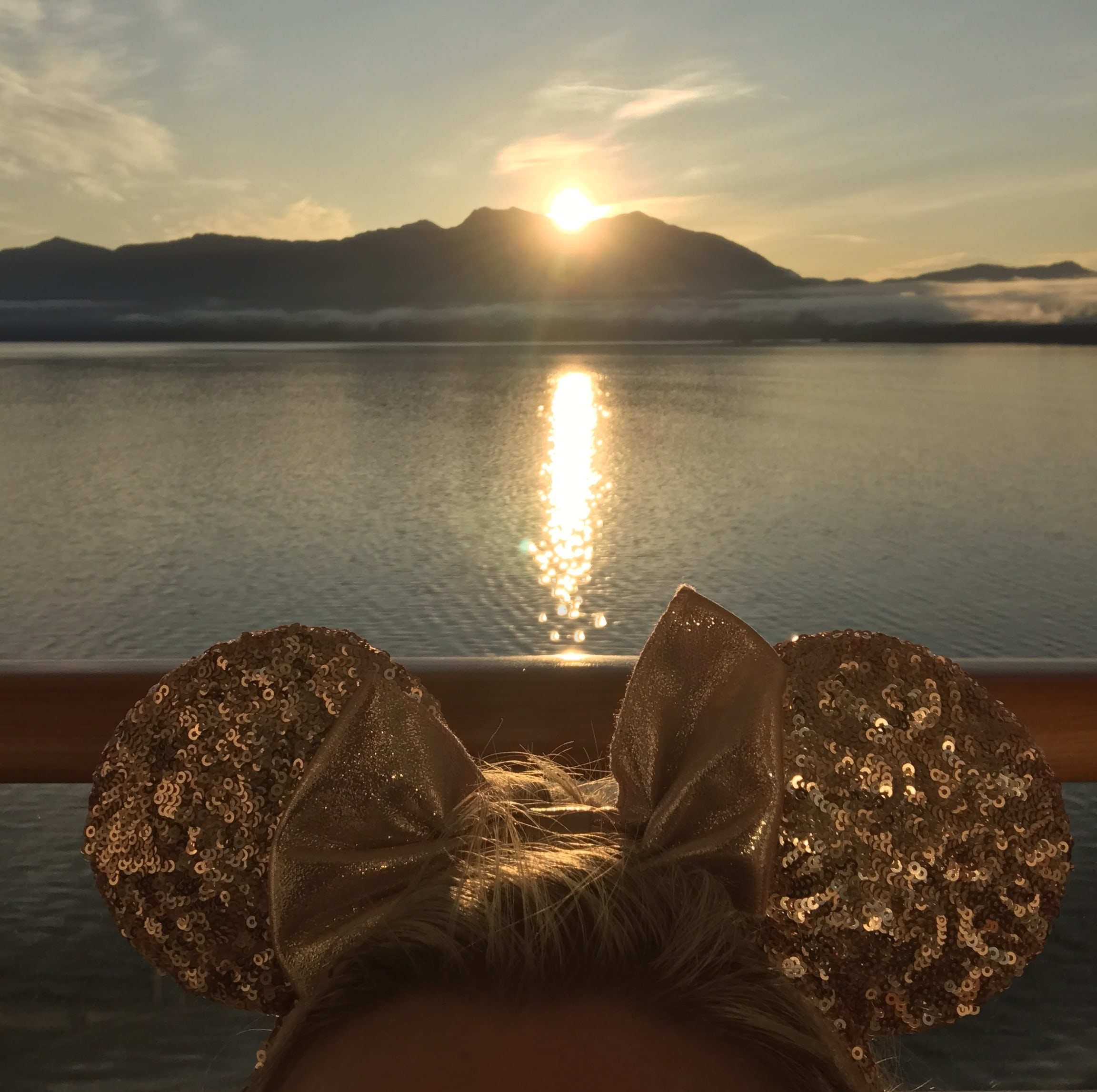 Minnie Mouse Ears Looking over Ocean Sunset on the Disney Wonder