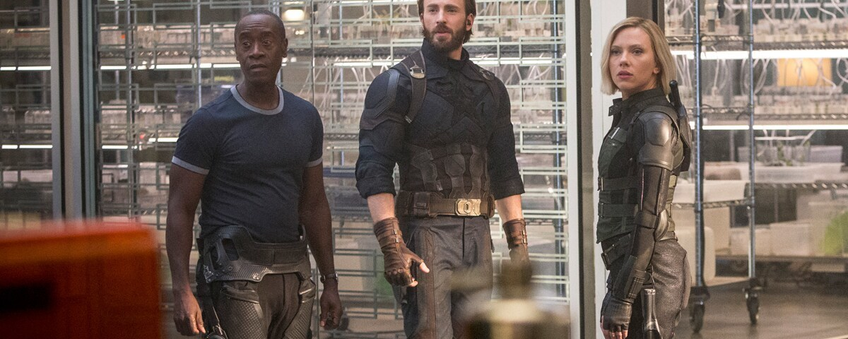 War Machine, Captain America, and Black Widow stand together in a scene from Avengers: Infinity War.