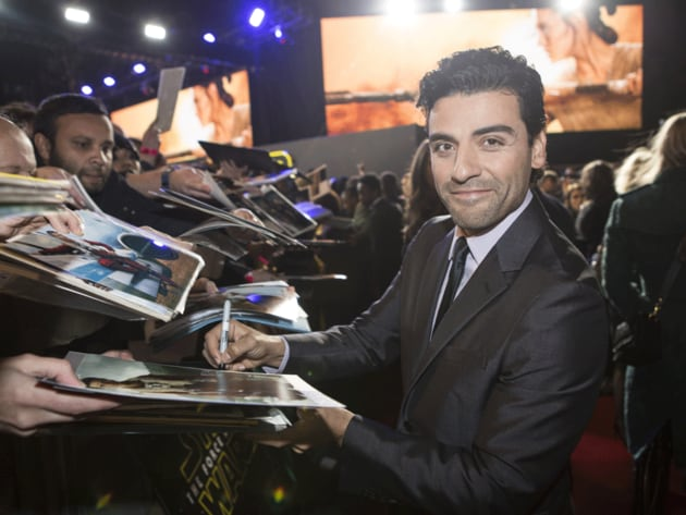 Oscar Isaac, Poe Dameron in The Force Awakens, happily signs autographs for fans at the European ...