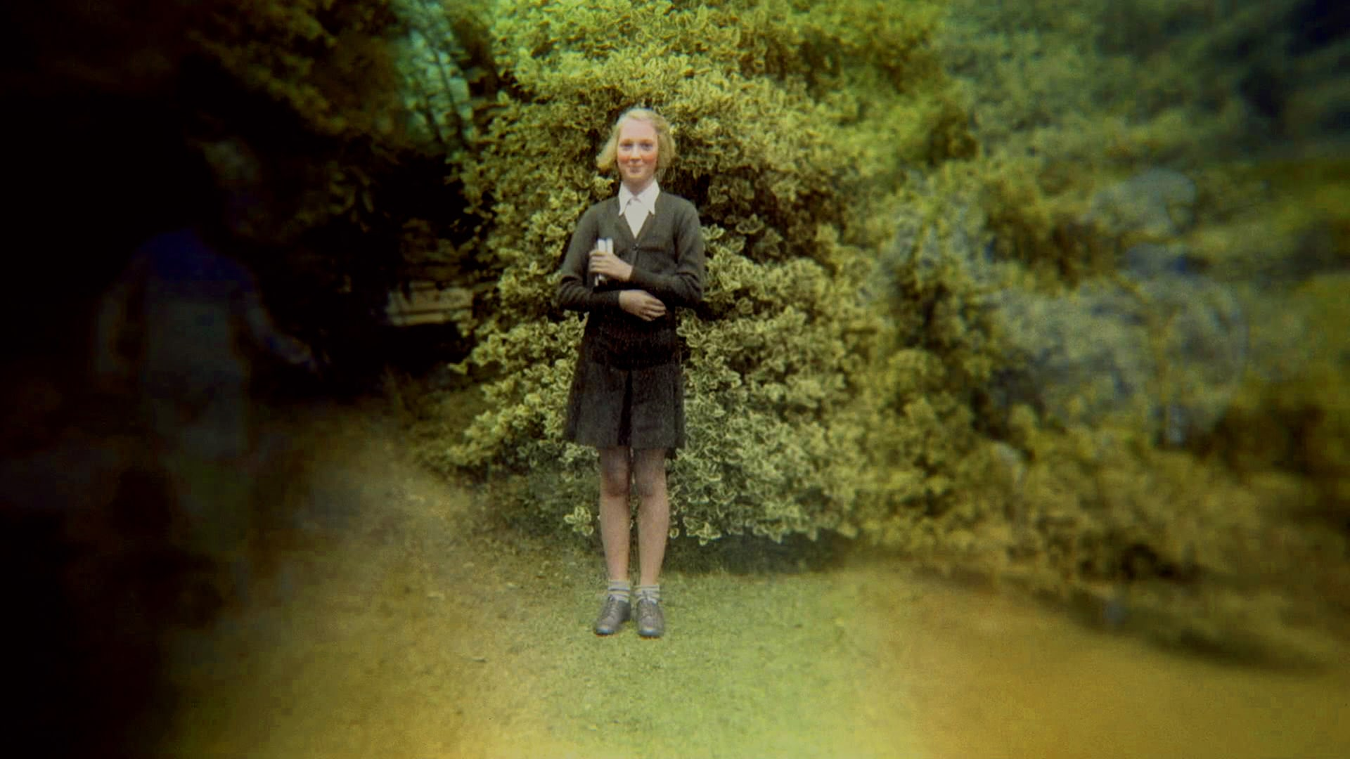 A young Jane Goodall poses for a picture in her school uniform in Bournemouth, England (Photo by Jane Goodall Institute)
