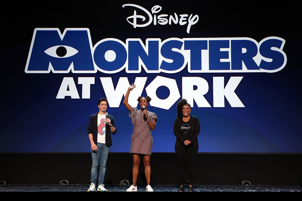 Monsters at Work cast on D23 stage; Ben Feldman, Aisha Tyler, and Yvette Nicole Brown
