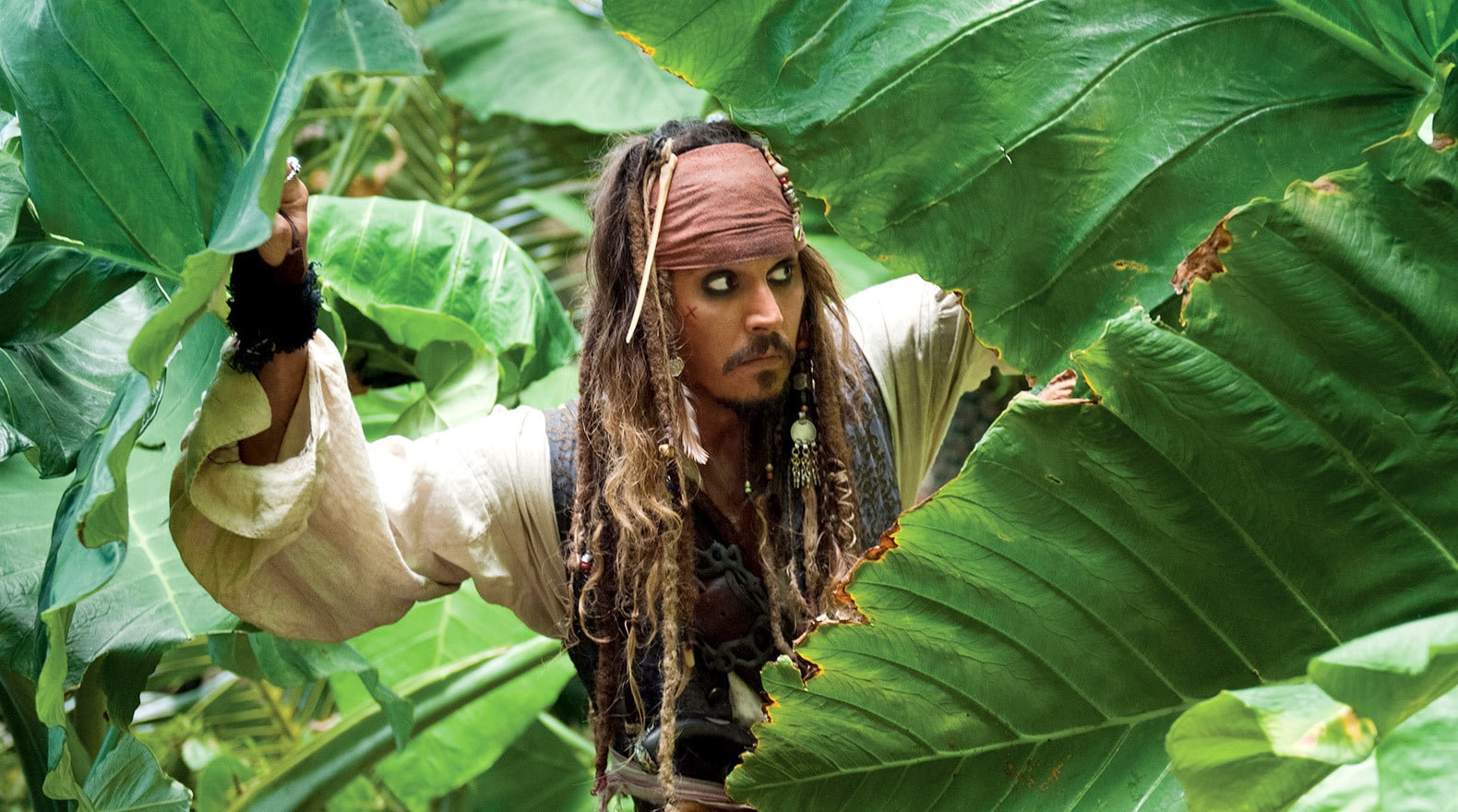 "Jack Sparrow traverses the jungle in a race for the ""Aqua de Vida"", the Fountain of Youth."