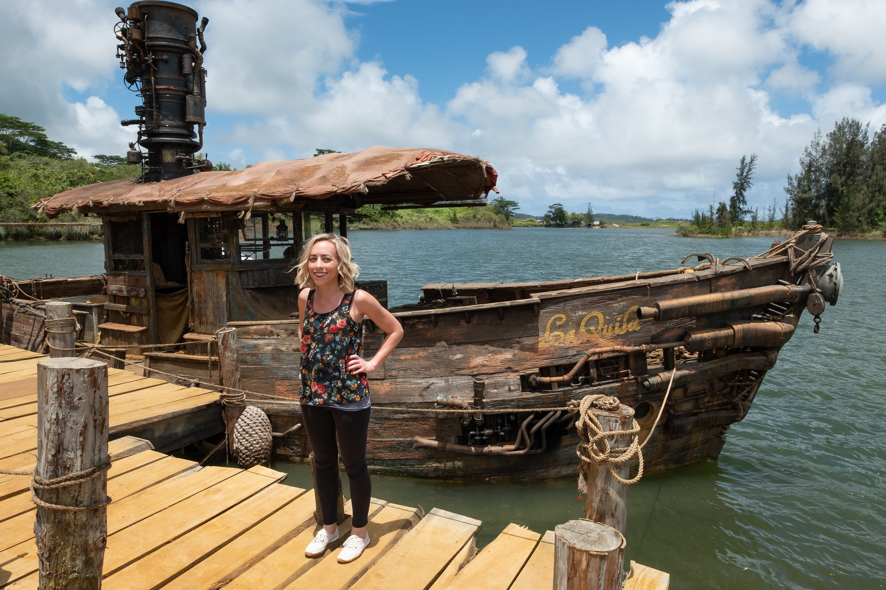Correspondent Michelle Lema standing in front of of the docked boat La Quila on set of Disney's Jungle Cruise