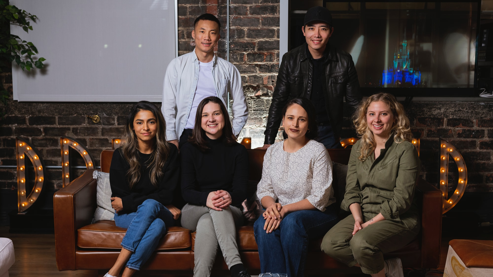 """Disney's """"LAUNCHPAD"""" Filmmakers Seated, l. to r.:  Aqsa Altaf (""""American Eid""""); Anne Marie Pace (""""Growing Fangs""""); Jessica Mendez Siqeiros (""""The Last of the Chupacabras""""); Stefanie Abel Horowitz (""""Let's Be Tigers"""").  Standing, l. to r.:  Moxie Peng (""""The Little Prince(ss)""""); Hao Zheng (""""Dinner is Served""""). Photo by Derek Lee. © 2021 Disney Enterprises, Inc. All Rights Reserved."""