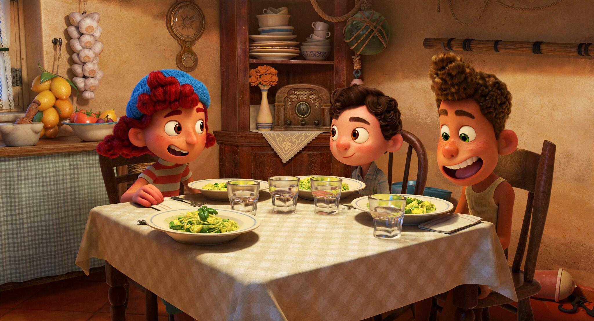 Luca, Alberto, and Guilia eat pasta