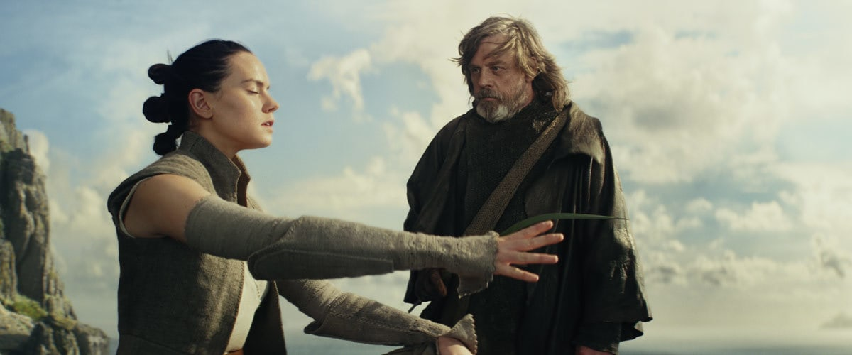 Luke Skywalker training Rey in the ways of the Force on Ahch-To