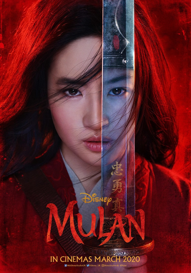 Close up of Mulan holding a sword in front of her face