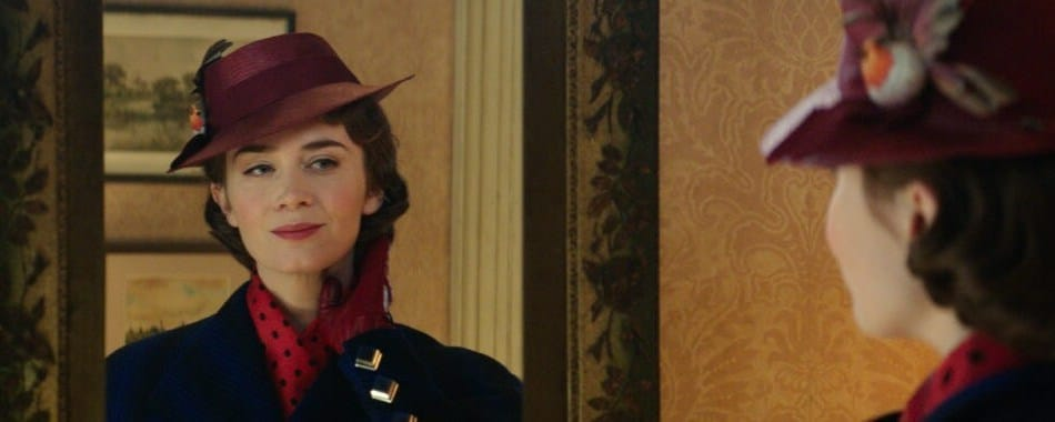 Emily Blunt as Mary Poppins looking in the mirror