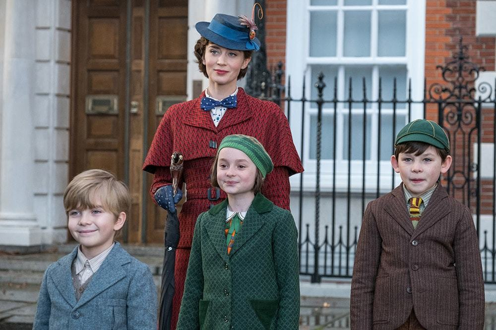 Mary Poppins with Annabel, John, and Georgie in front of the Bank's residence