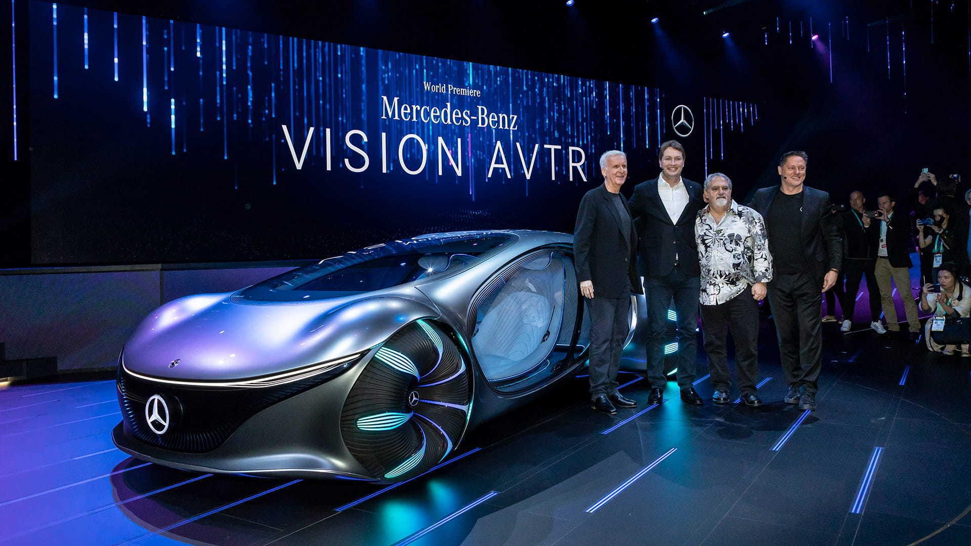 James Cameron, Ola Källenius, Jon Landau and Gorden Wagener pose with the VISION AVTR at CES 2020.