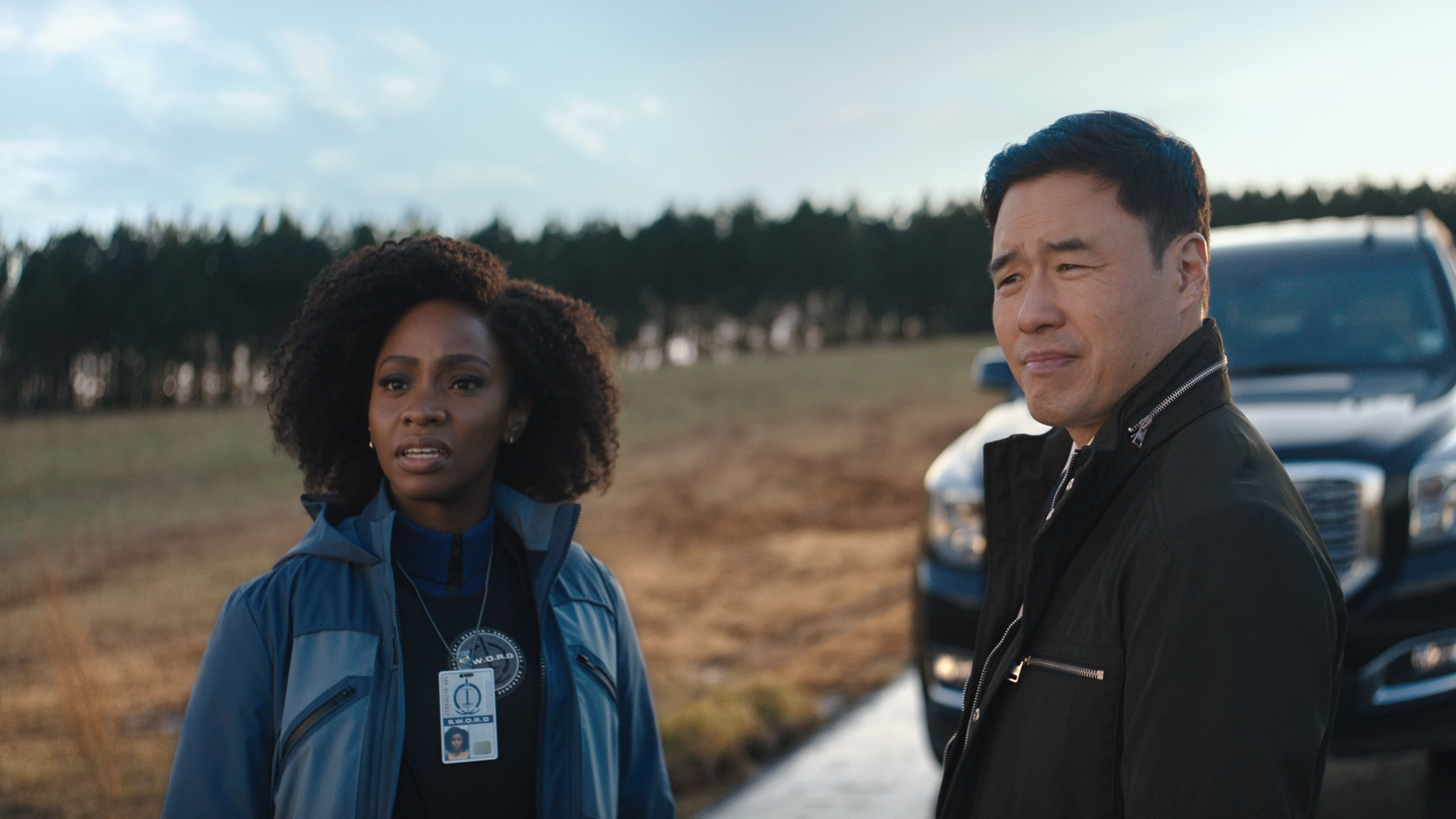 (L-R): Teyonah Parris as Monica Rambeau and Randall Park as Jimmy Woo in Marvel Studios' WANDAVISION exclusively on Disney+. Photo courtesy of Marvel Studios. ©Marvel Studios 2021. All Rights Reserved.