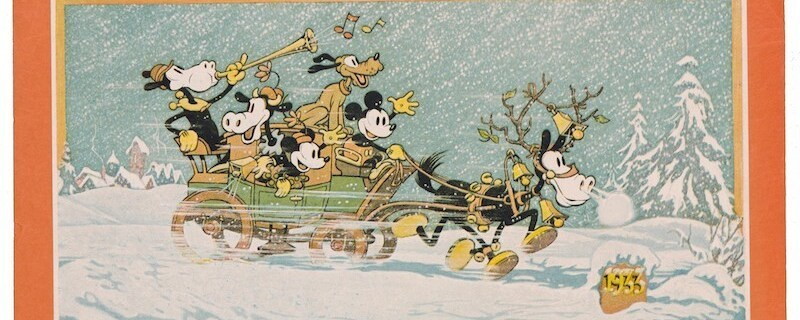 Mickey and friends riding in a sled with reindeer in the snow