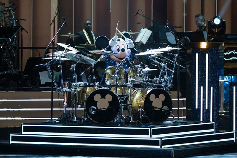 Mickey playing the drums