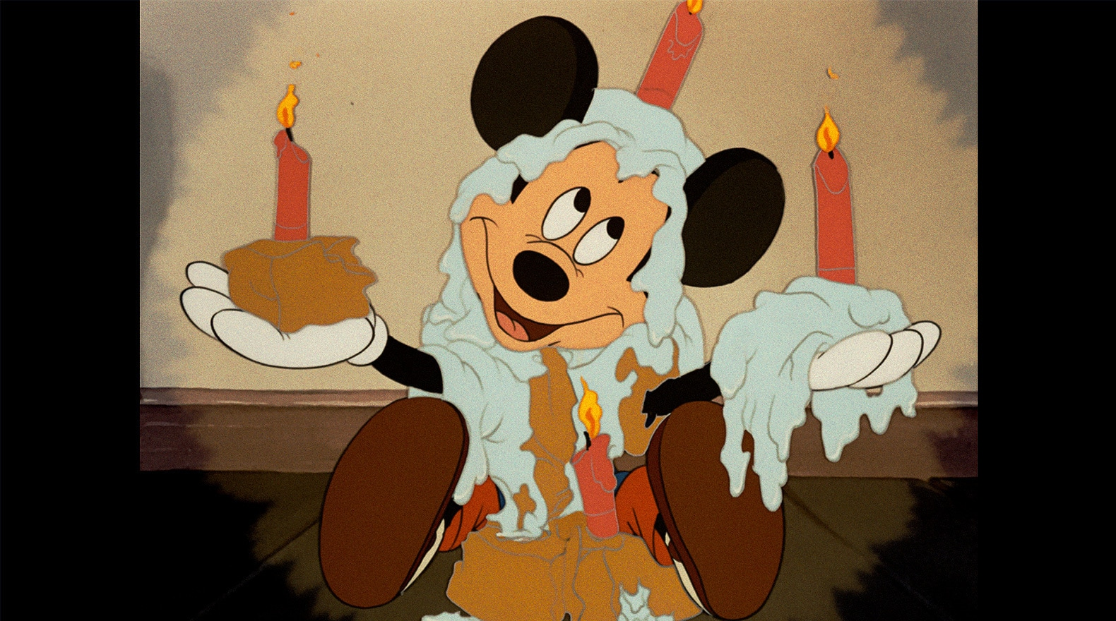 Mickey celebrates his day with a little cake and candles.