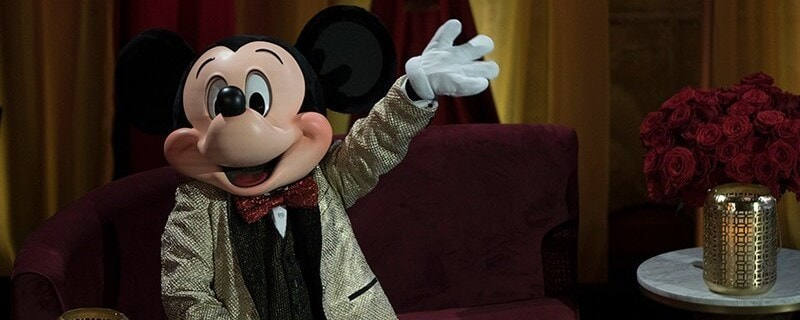 Mickey wearing Shimmering gold tuxedo and red bowtie