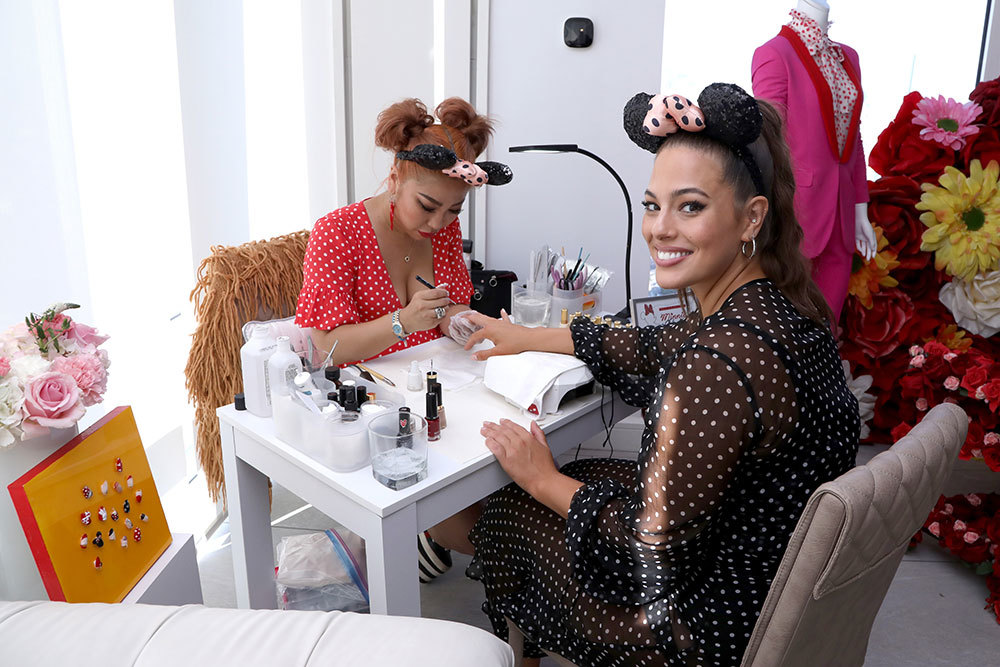 Britney Tokyo painting Ashley Graham's nails at the Minnie Style Suite