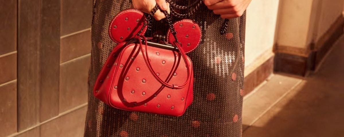 Purse and dress from Coach's Minnie Mouse Collection