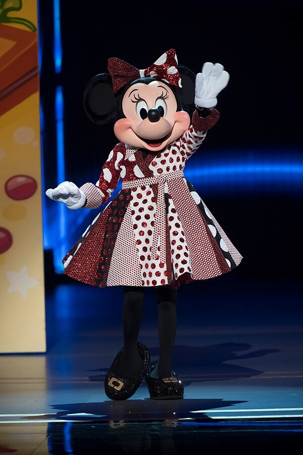 Minnie Mouse in shimmering red and white dress