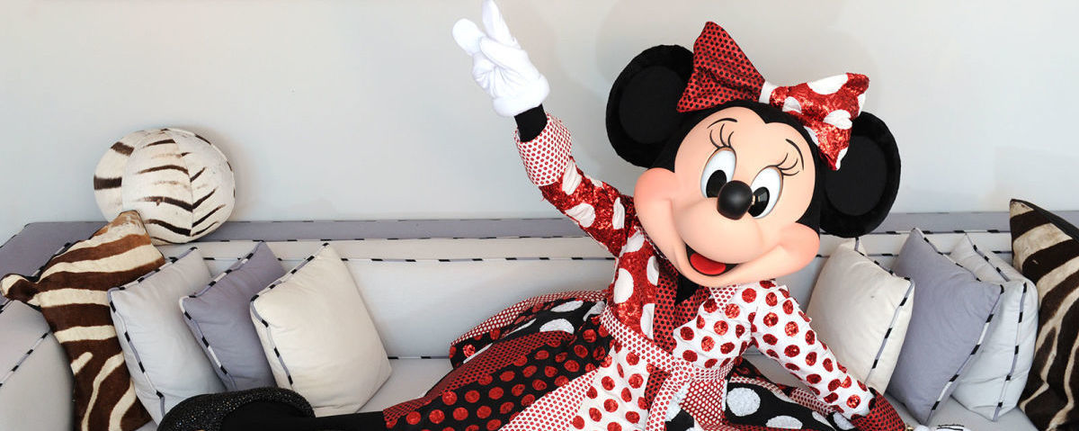 Minnie Mouse posing in Diane Von Furstenberg's bespoke dress for her 90th anniversary