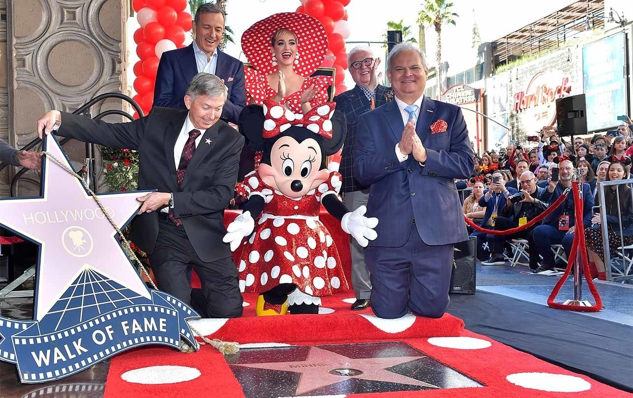 Bob Iger and Minnie Mouse celebrate receiving an official star on the Hollywood walk of fame