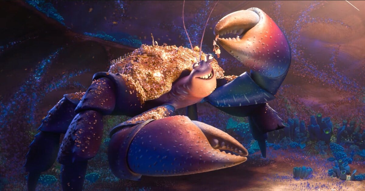 "Animated character Tamatoa holding gold treasure from the film ""Moana"""