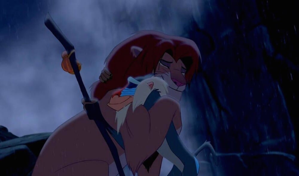 Animated characters Simba (lion) and Rafiki (baboon) hugging