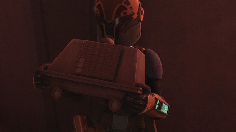 Sabine Wren holding a mouse droid