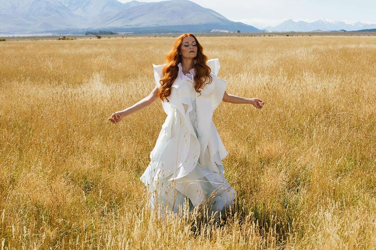 """Reese Witherspoon in a field in the movie """"A Wrinkle in Time"""""""