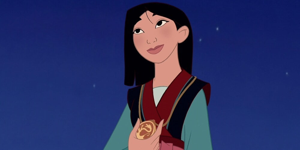 "Mulan holding a gold medal around her neck in the animated movie ""Mulan"""
