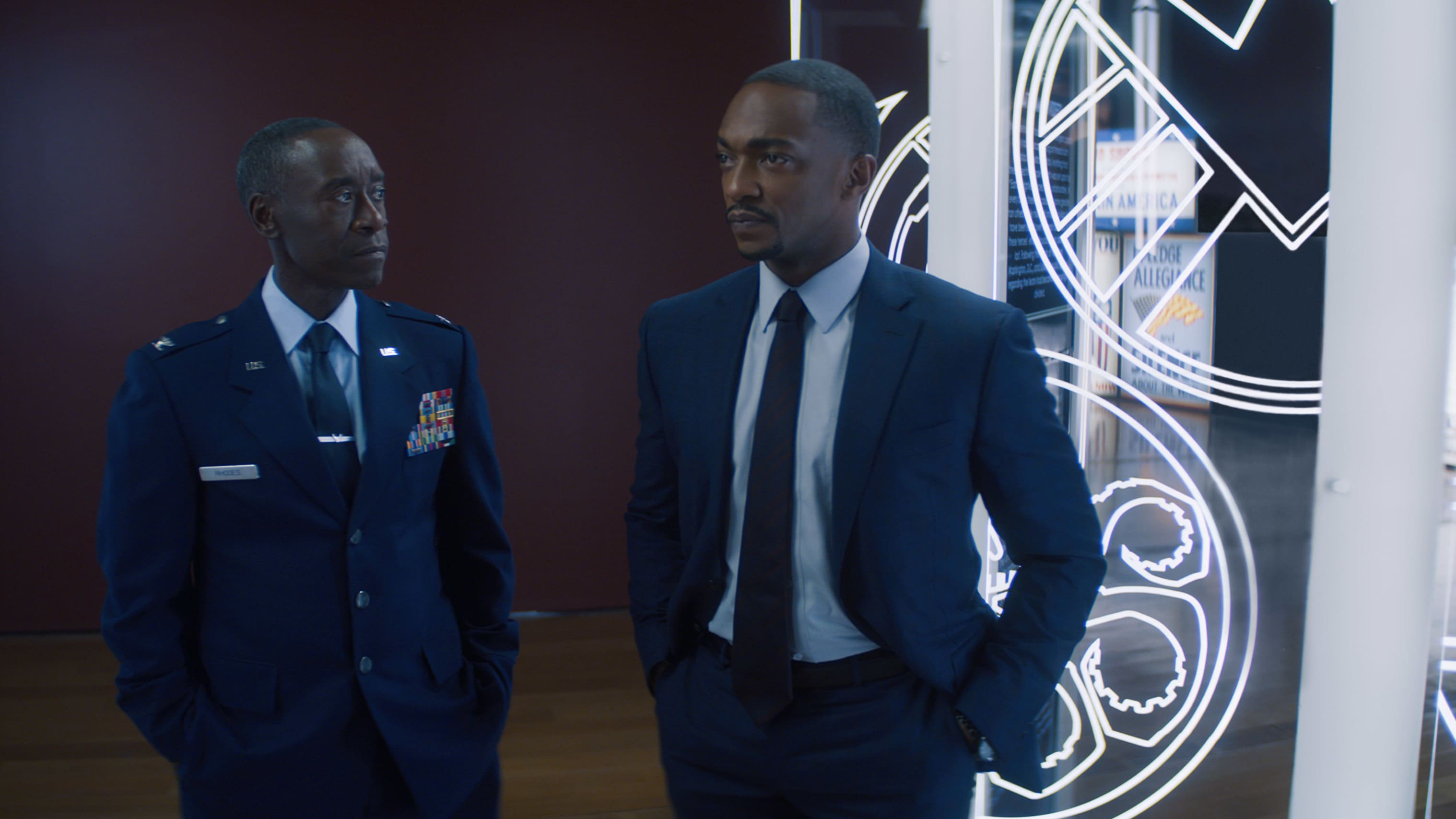 (L-R): Rhodey (Don Cheadle) and Falcon/Sam Wilson (Anthony Mackie)  in Marvel Studios' THE FALCON AND THE WINTER SOLDIER exclusively on Disney+. Photo courtesy of Marvel Studios. ©Marvel Studios 2021. All Rights Reserved.