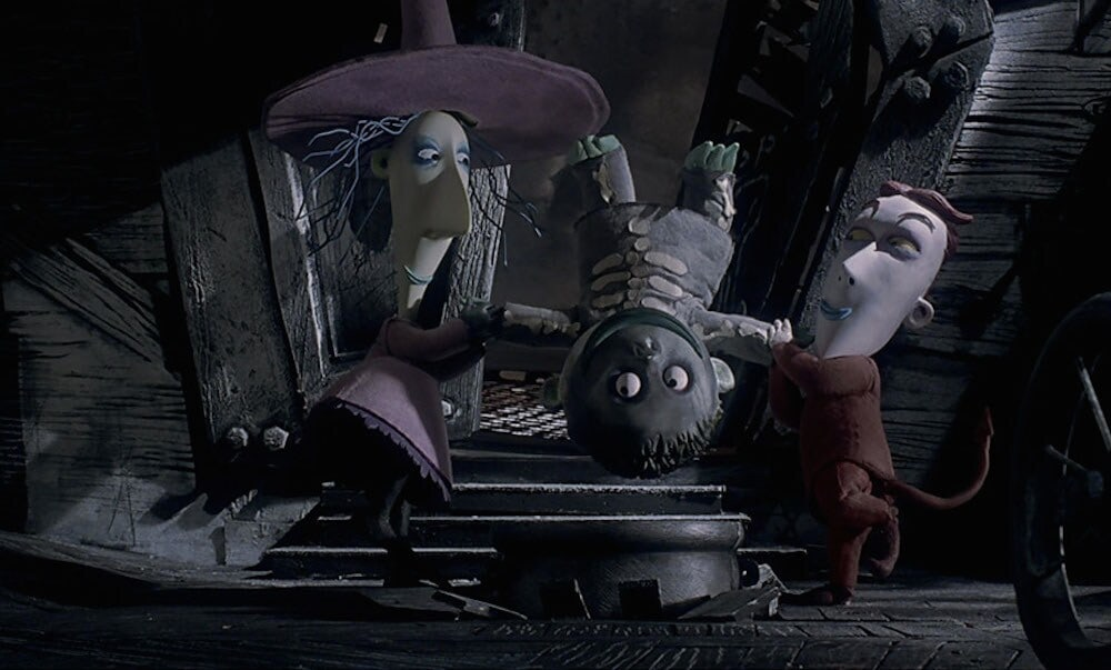 "Lock and Shock holding Barrel upside down in the film ""The Nightmare Before Christmas"""