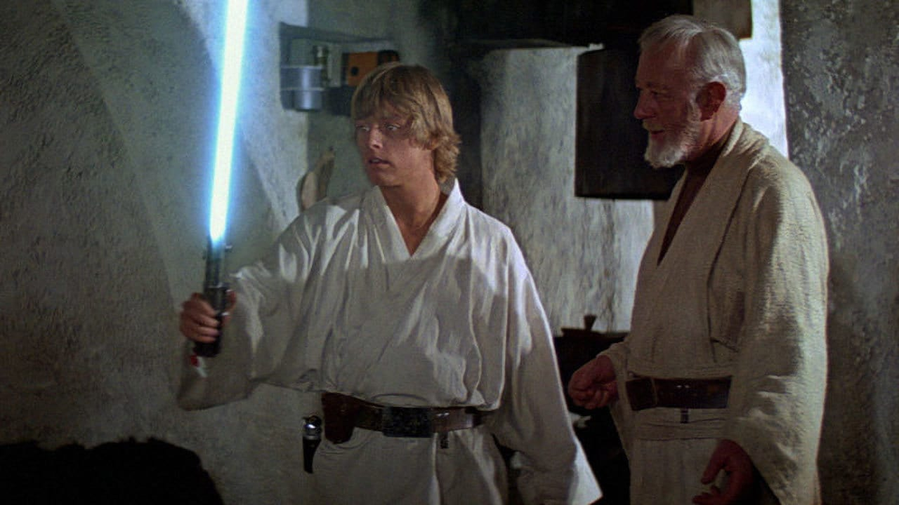 Obi-Wan giving Luke the Skywalker lightsaber