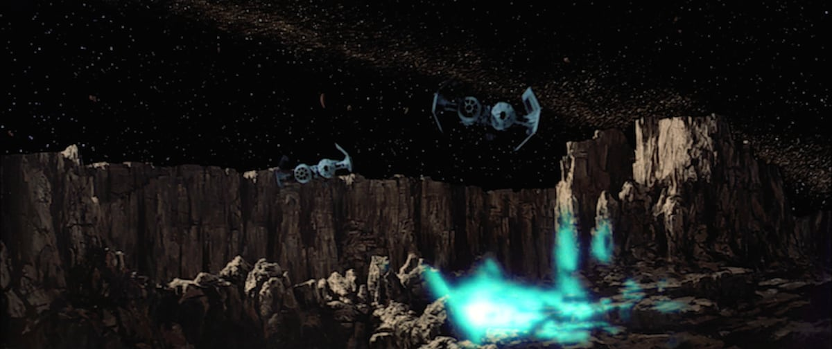 TIE bombers dropping bombs in an asteroid field