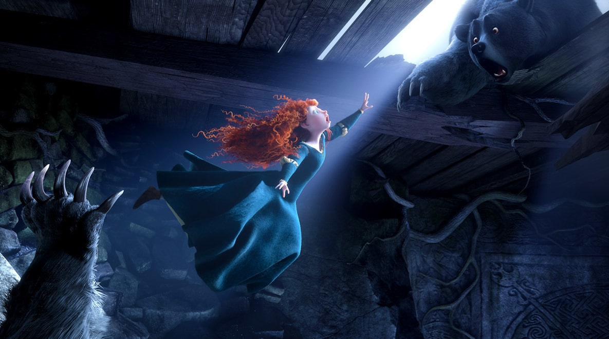 Merida, voiced by Kelly Macdonald, reaching for her mother who has taken the form of a bear in the movie Brave.